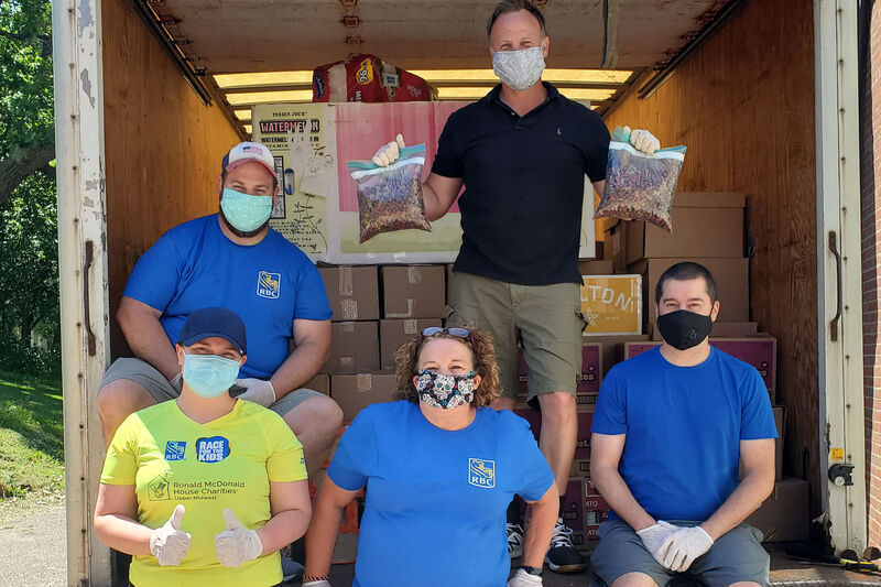 Keystone Community Services volunteers in the back of a mobile food pantry