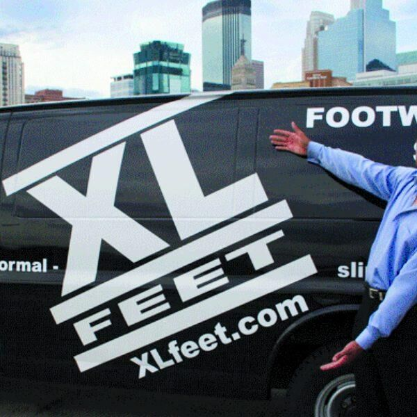 Small business owner Adrian Coulter in front of his company van for XLFeet.com