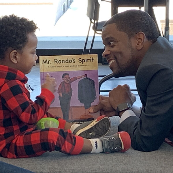 Mayor Melvin Carter III reads at an In Black Ink event