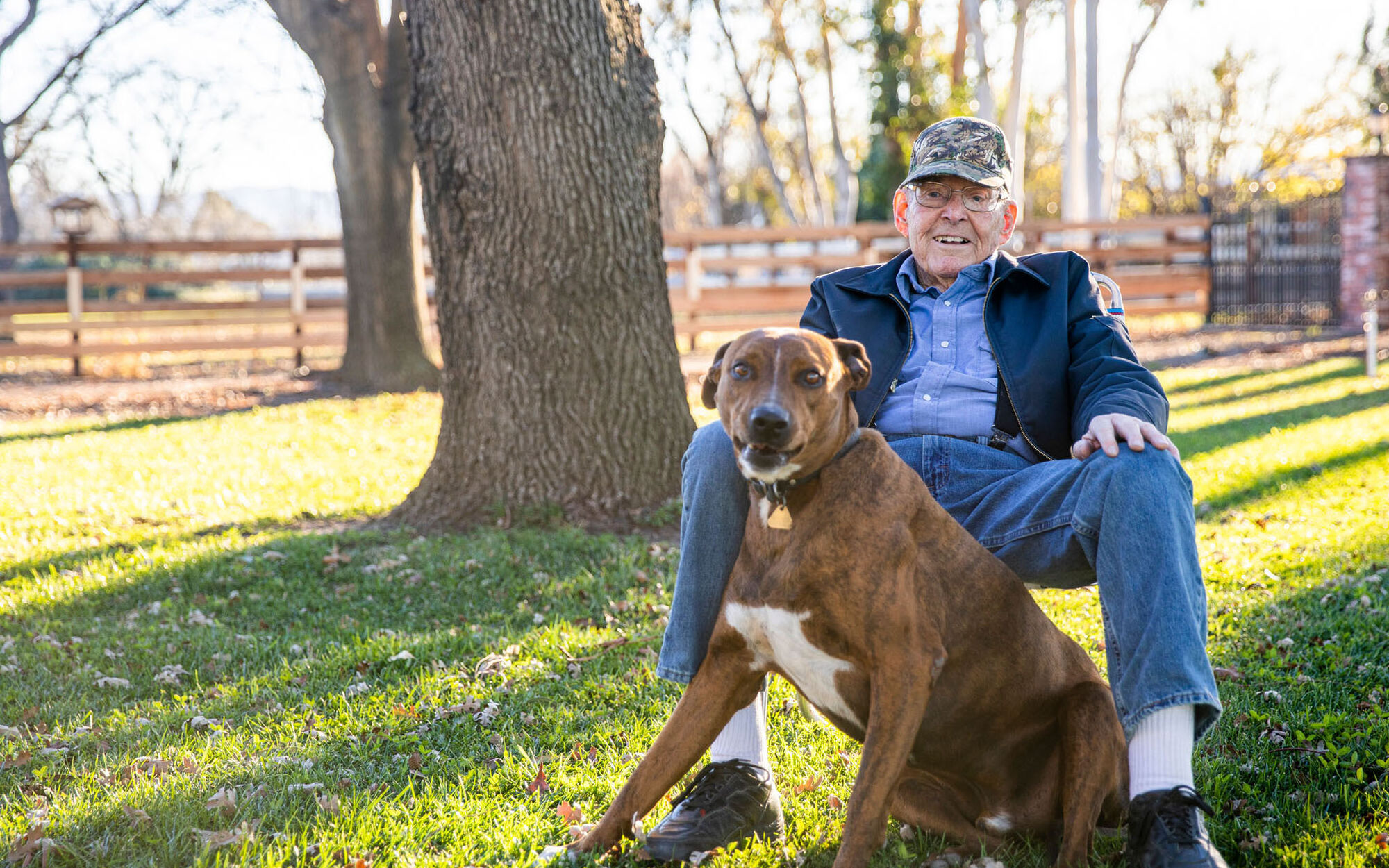 Retained life estate donor Jack sitting outside with his dog