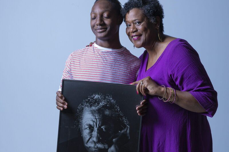 What we do advocate for equity new narrative project members holding photo of gordon parks
